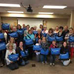 Volunteers and staff put together more than 200 chemo care kits on a rainy day in October.