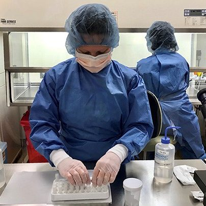 COVID-19 vaccine development researchers at work at Providence's Earle A. Chiles Research Institute, June 5, 2020.